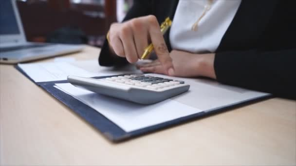 female accountant making calculations and taking notes