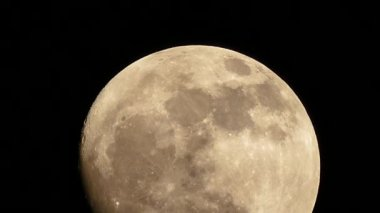 Moon shines through clouds