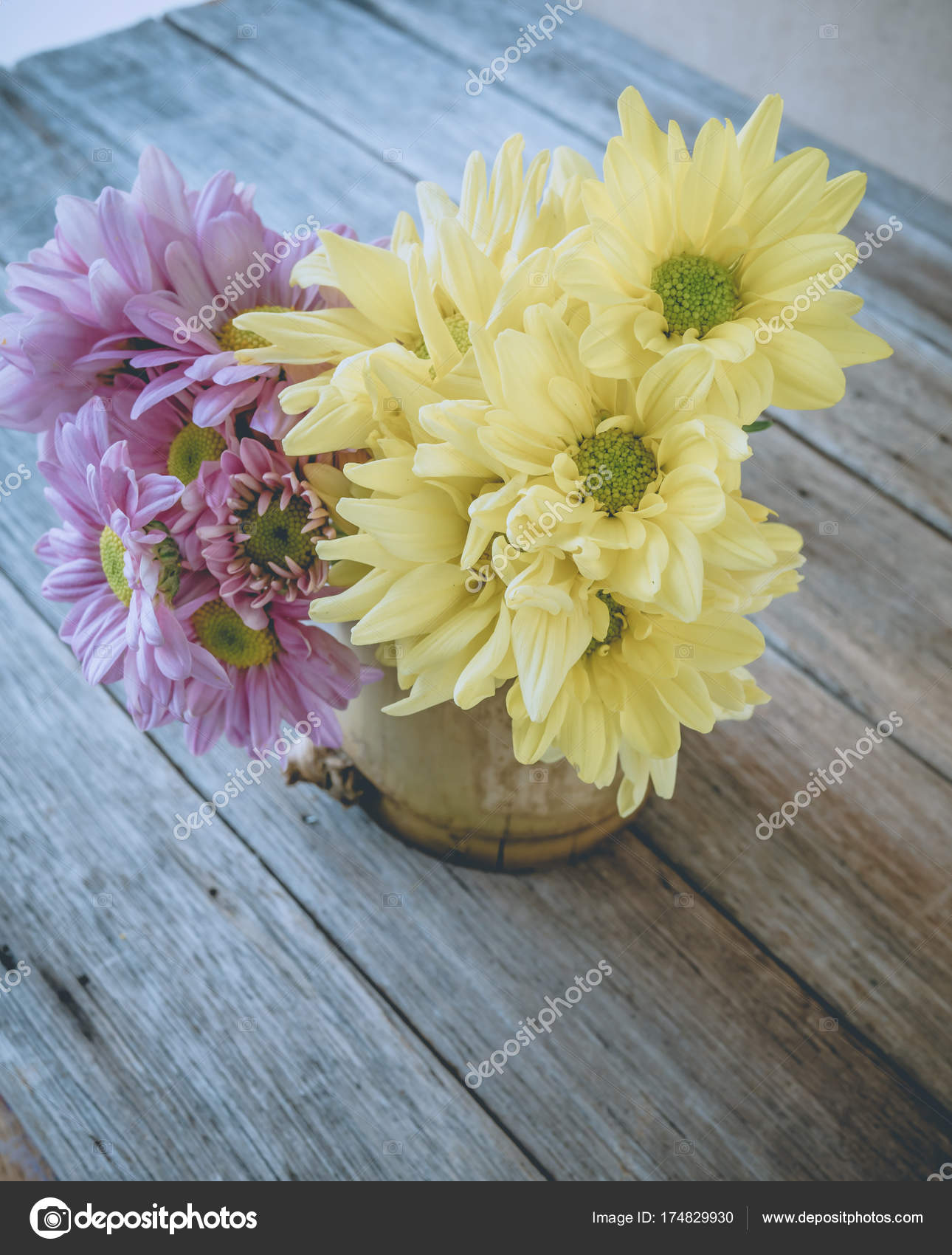 Retro Image Pink And Yellow Flower In Bamboo Vase On Table Vin