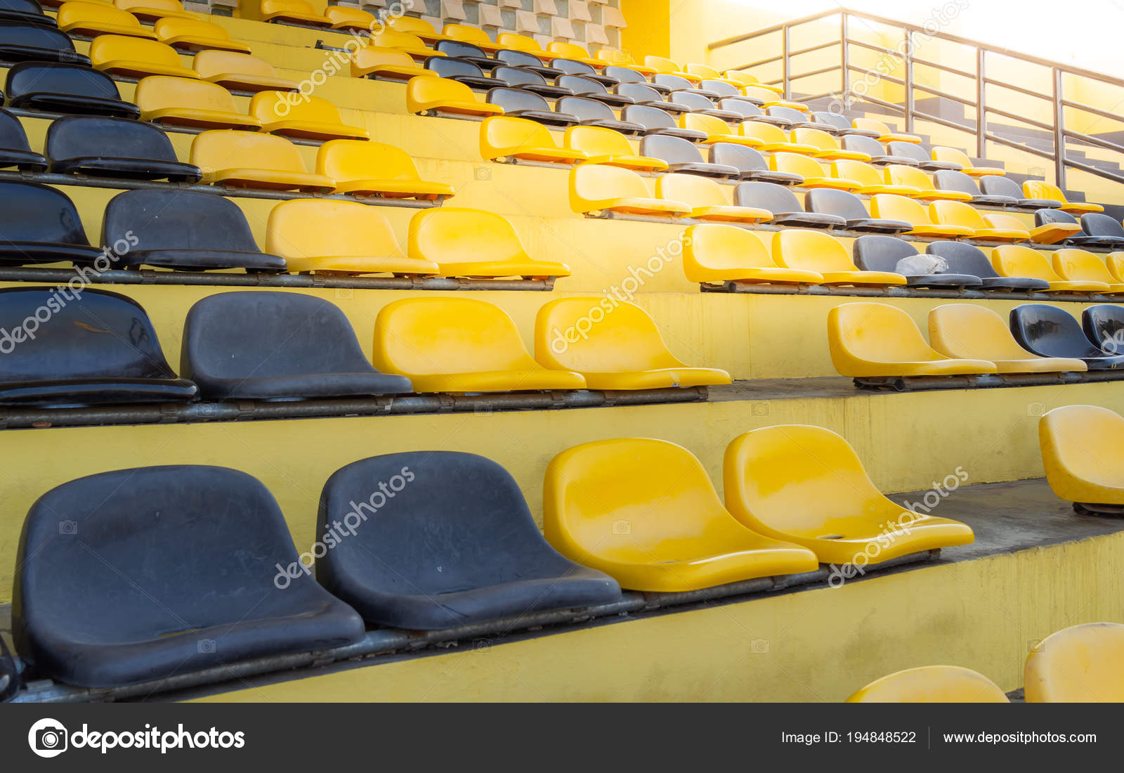 Image result for black and yellow stadium seats