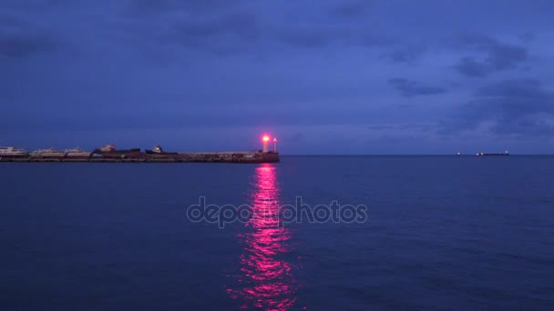 Reflection of the light of the lighthouse at night
