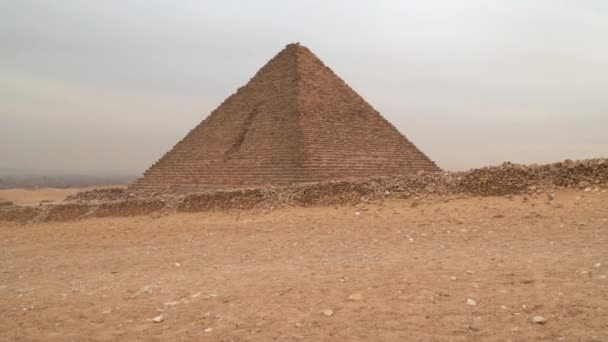 Pyramid of Menkaure in Giza against the backdrop of an overcast sky. Egypt