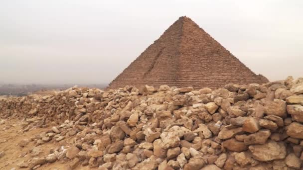 The Pyramid of Menkaure is the smallest of the three main Pyramids of Giza, located on the Giza Plateau in the southwestern outskirts of Cairo, Egypt