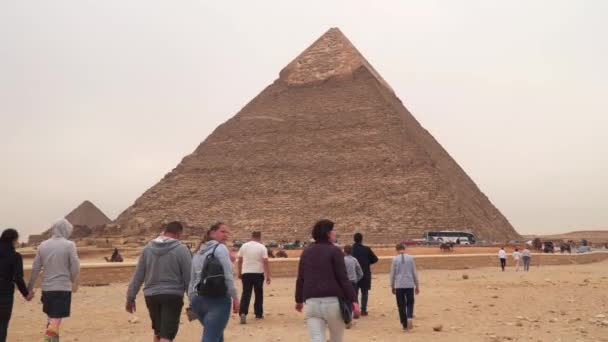 Giza , Egypt - January 14, 2020 :Tourists near the pyramid of Khafre. The Pyramid of Khafre or of Chephren is the second-tallest and second-largest of the Ancient Egyptian Pyramids of Giza