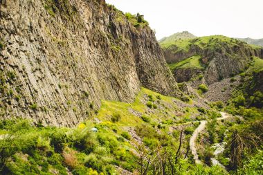 Mountain valley landscape with unique geological formation called Symphony of Stones. Basalt rock. Ecotourism. Nature background. Adventure holiday. Armenia, Garni. Travel vacation. Climbing tourism