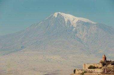 Khor Virap Monastery. Mount Ararat on background. Exploring Armenia. Armenian architecture. Tourism and travel concept. Mountain landscape. Religious landmark. Tourist attraction. Copy space for text