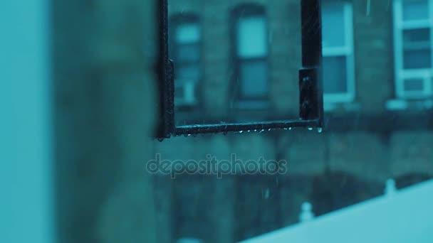 Rain drops bouncing on the fire escape ladders
