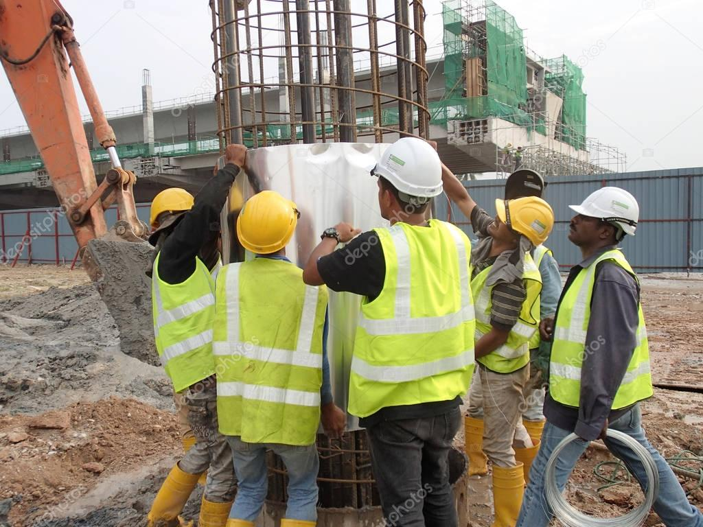 Construction workers discuss among themselves