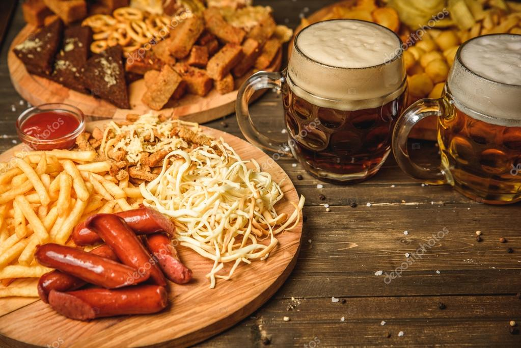 snacks to beer on wooden background top view