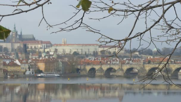 From distance view of the famous medieval Charles Bridge in Prague city.