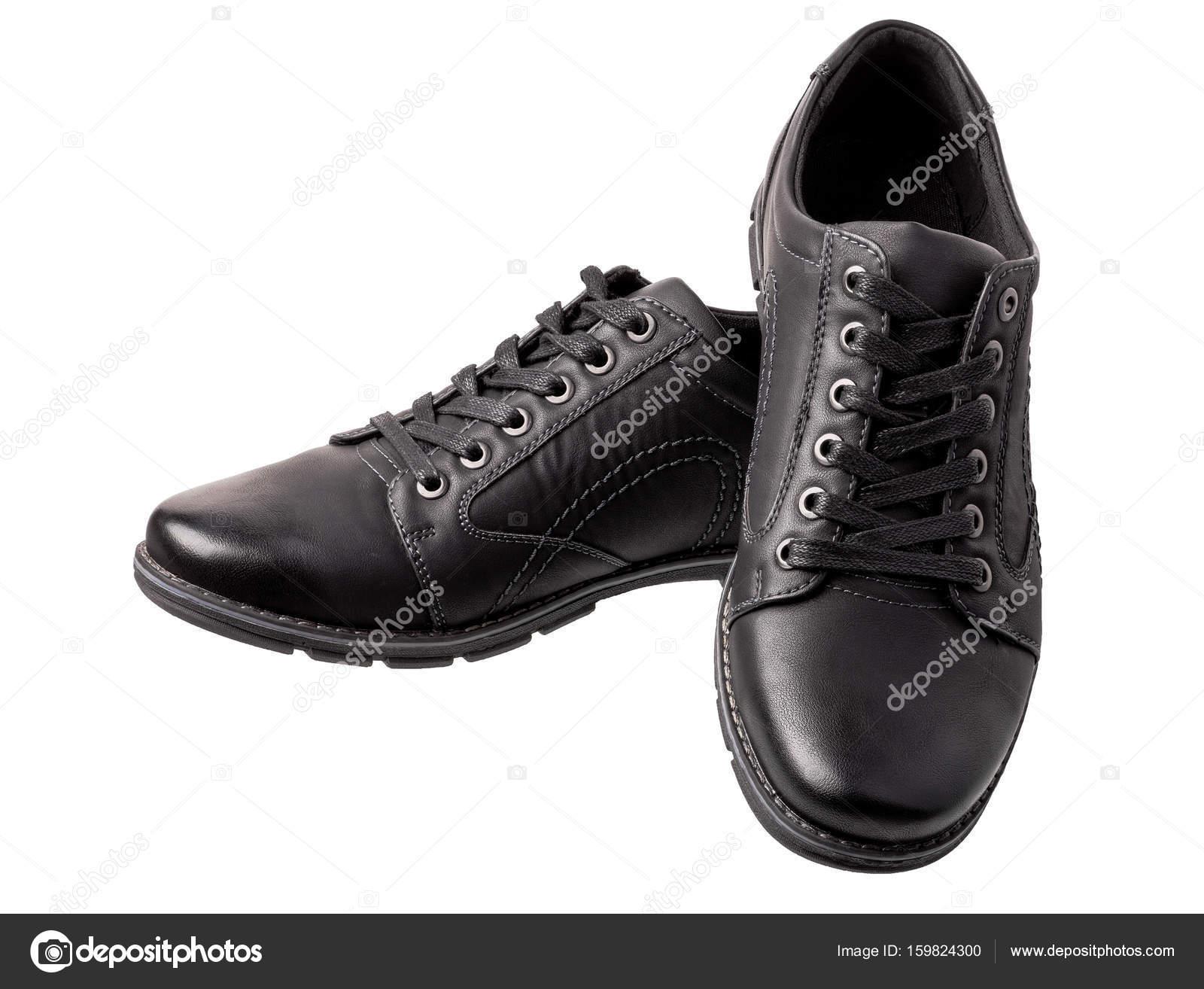 d74d8d14c1a Ζευγάρι παπούτσια μαύρο άνδρες που απομονώνονται σε λευκό φόντο. Υποδήματα  βρίσκεται σε γωνία με την camer — Εικόνα από ...