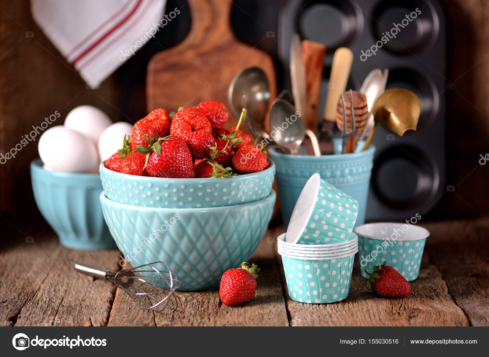 Kitchen Accessories For Cooking Muffins, Organic Strawberries And Eggs On  An Old Wooden Background.