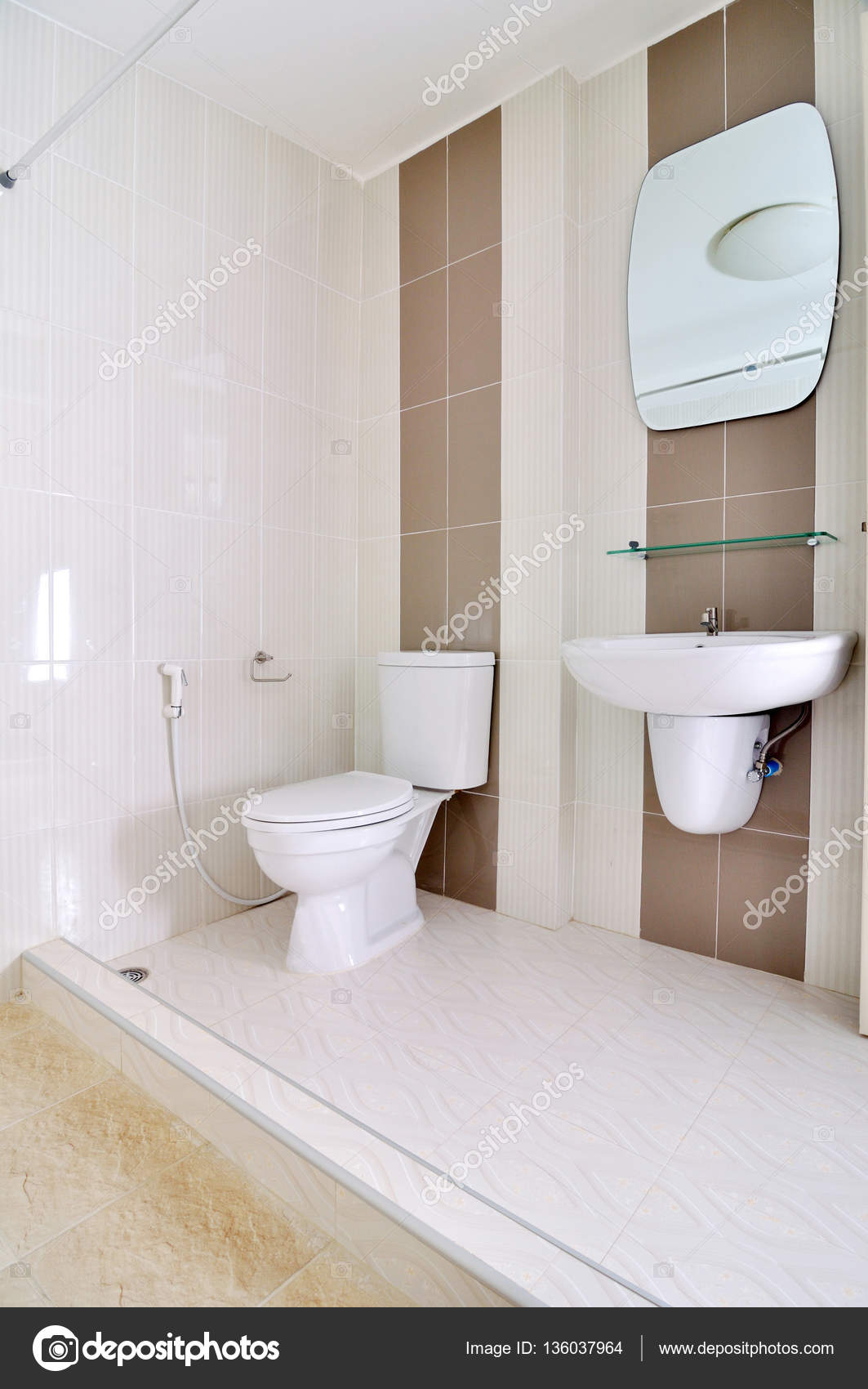 Nice small simple bathroom with sink and toilet stock for Simple small bathroom