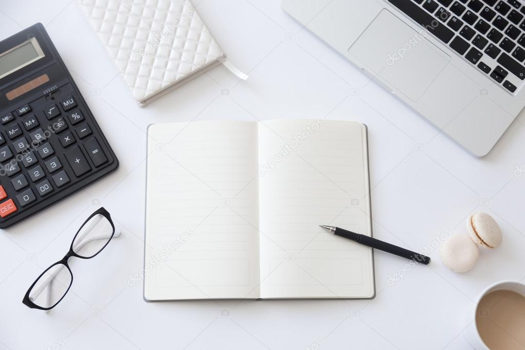 Top view of a working desk with open notebook ⬇ Stock Photo, Image by ©  fizkes #126998082