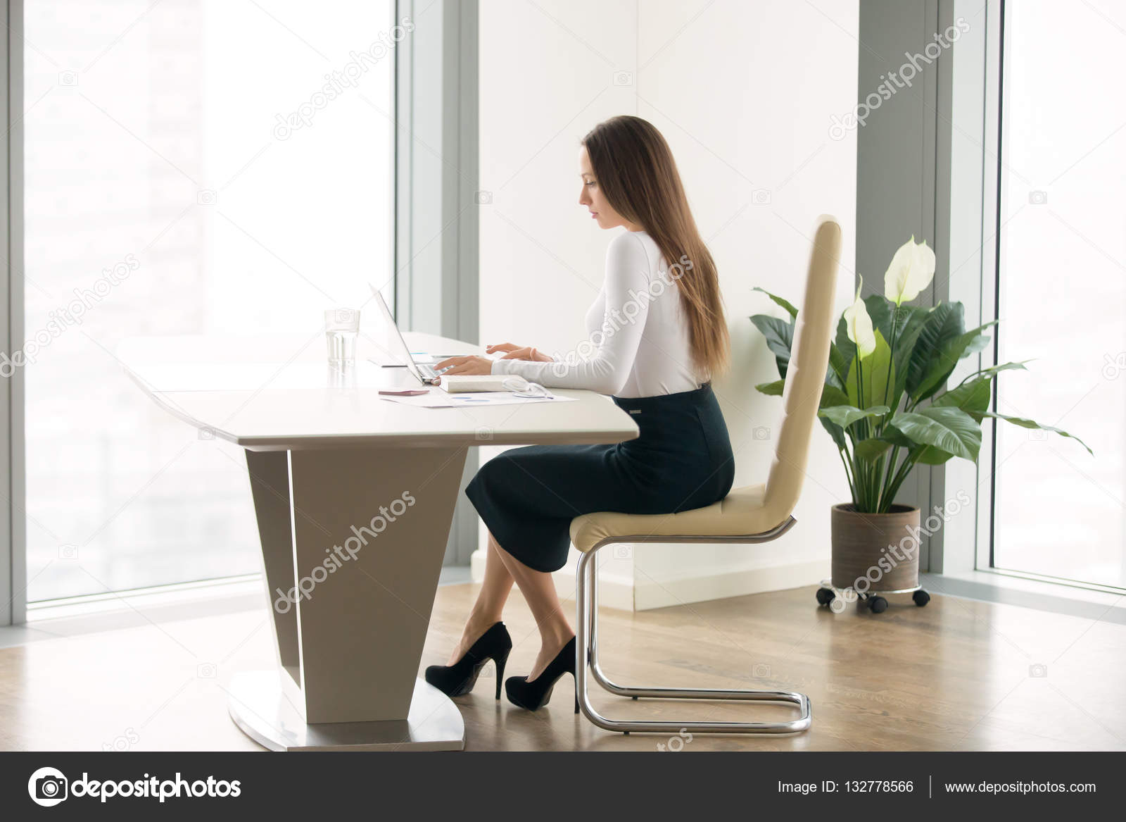 office furniture women pregnant women young woman working at the office desk stock photo fizkes 132778566