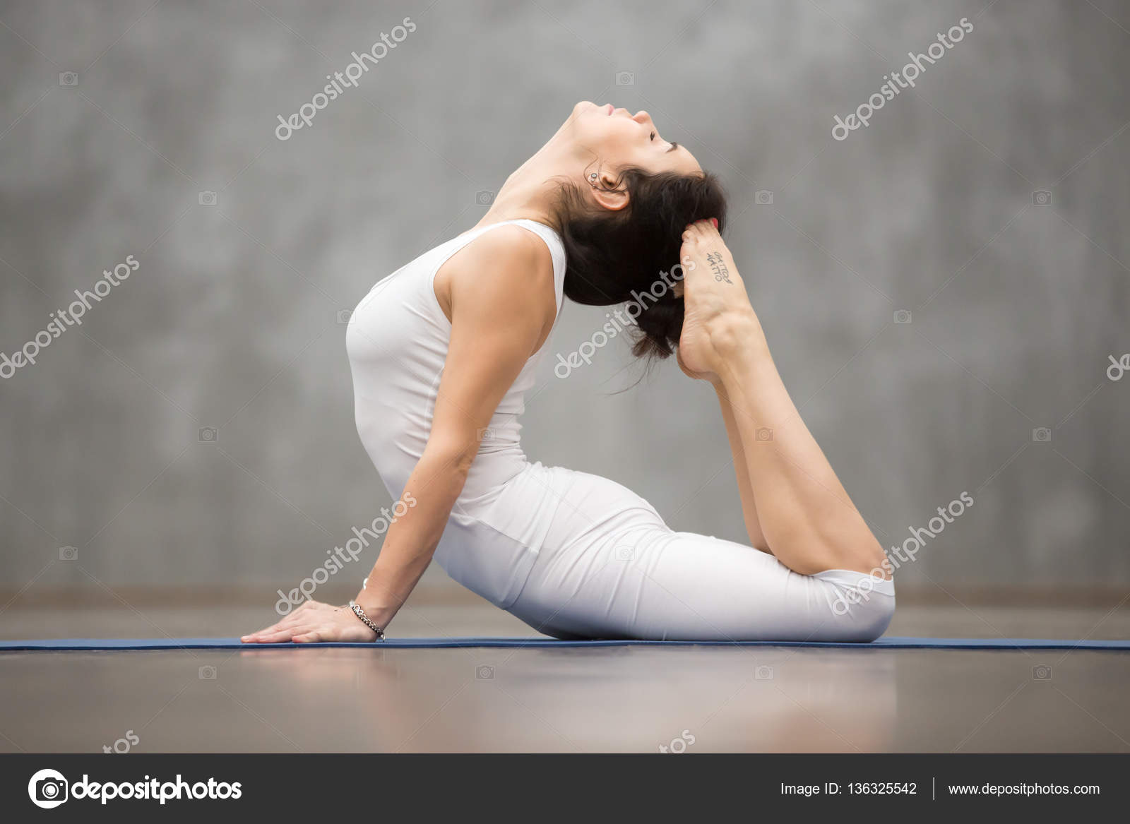 Beautiful Yoga Royal Cobra Pose Stock Photo