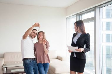 Getting keys after buying apartment, couple and real estate agen