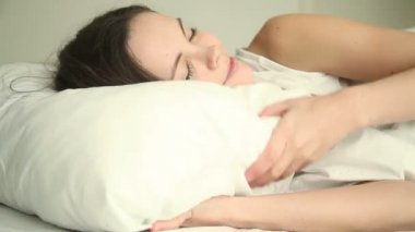 Young woman having good dream