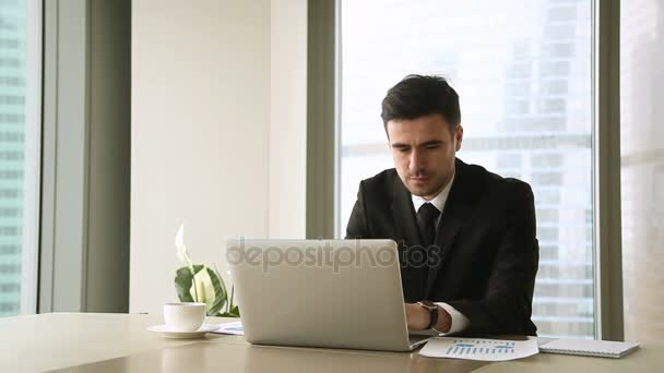 Young businessman analyzing diagrams graphs, satisfied with company income growth