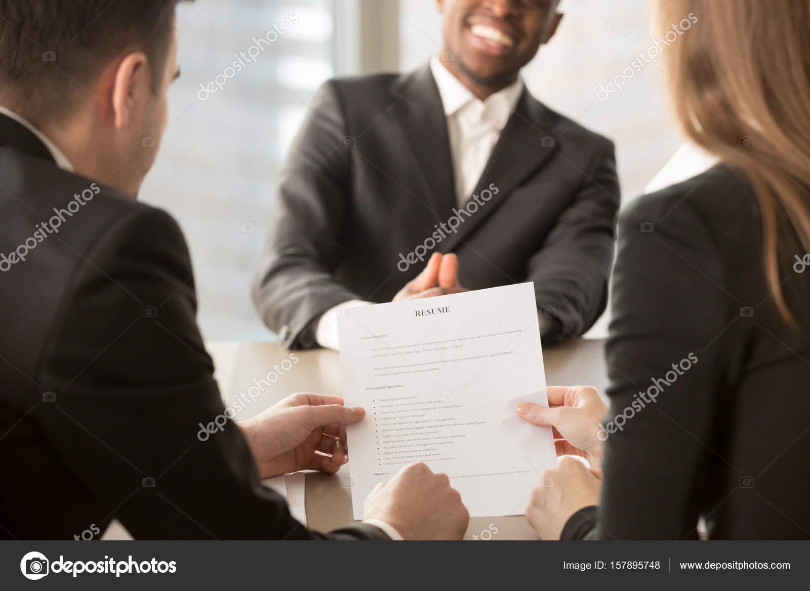 Employers recruiters reviewing resume, happy applicant at backgr ...