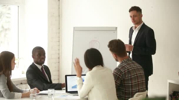Diverse businesspeople asking answering questions at boardroom meeting, giving presentation
