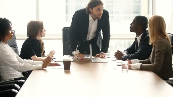 Angry boss scolding employee for bad work result at meeting