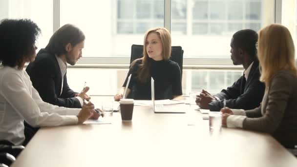Dissatisfied female bad boss reprimanding male employee at team meeting