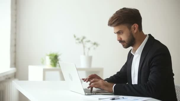 Productive satisfied businessman leaning back finishing office work on laptop