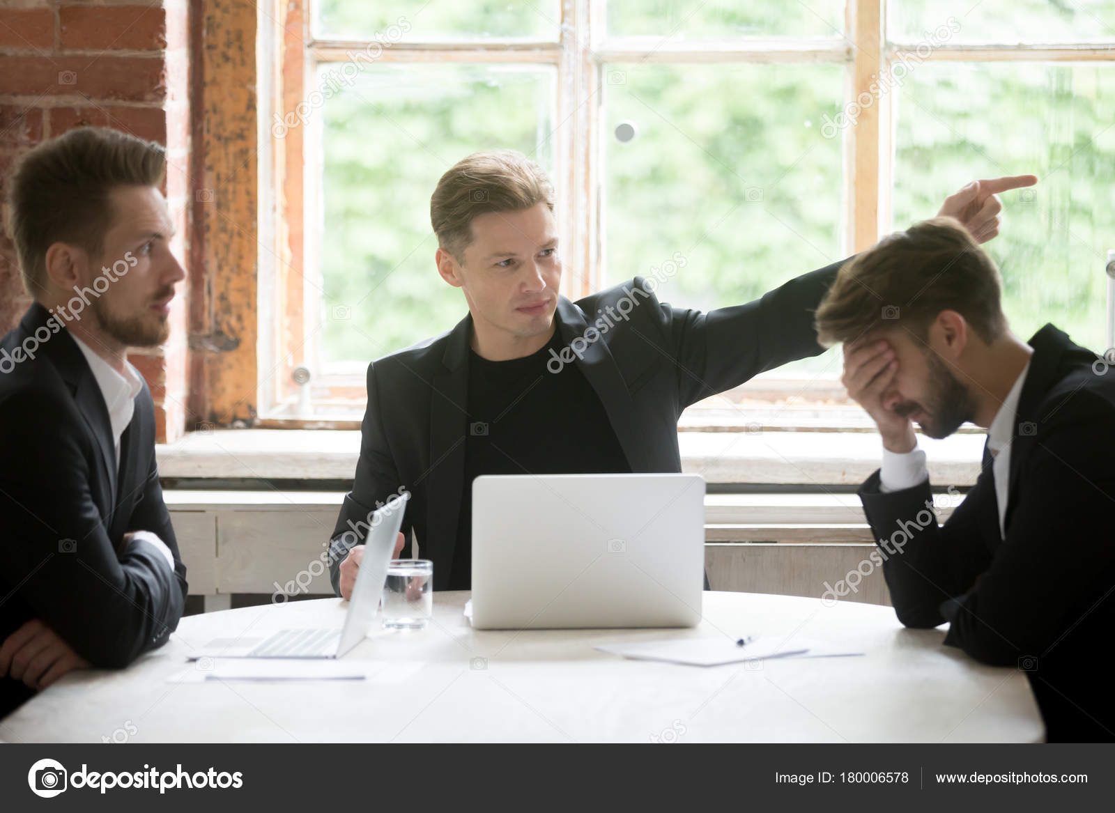 office meeting. Angry Boss Firing Employee With Hand Gesture At Office Meeting \u2014 Stock Photo