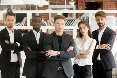 Team portrait, group of confident businesspeople standing lookin