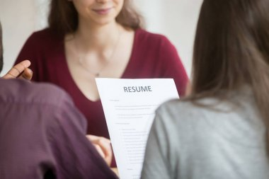Multiracial hr managers holding reading candidates resume during