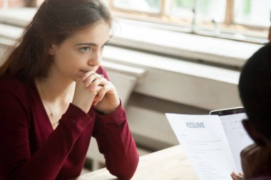 Nervous stressed female applicant waiting for result at hiring negotiations, insecure woman candidate feeling worried while hr managers read discuss her cv resume, bad failed job interview concept stock vector