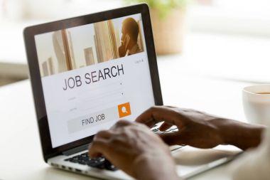 African-american man browsing work online using job search compu