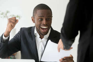 Excited african american employee receiving notice about promoti