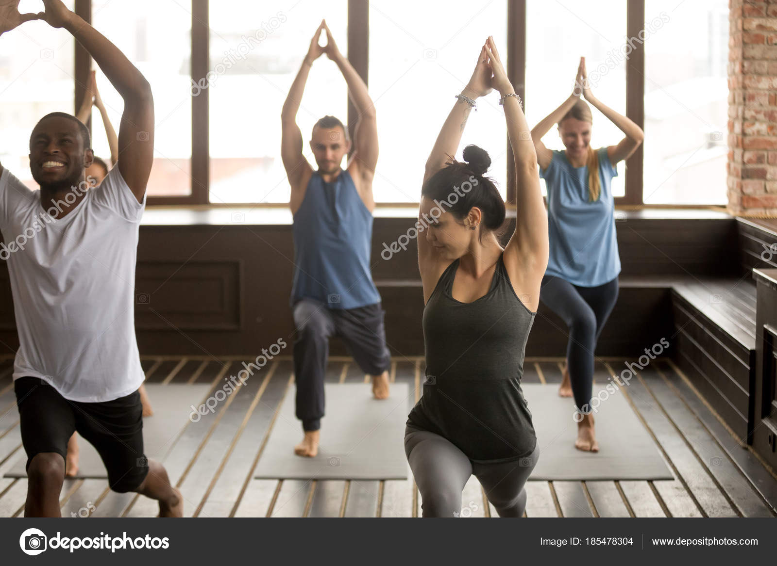 Group Yoga In Studio Diverse People Doing Exercises With Instru Stock Photo
