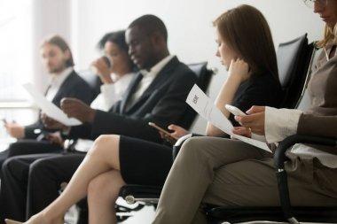 Multi-ethnic applicants sitting in queue waiting for job intervi