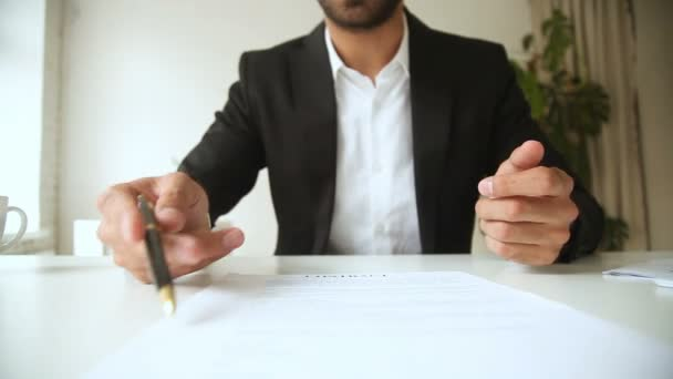 Businessman holding pen pointing on contract, offering to sign document