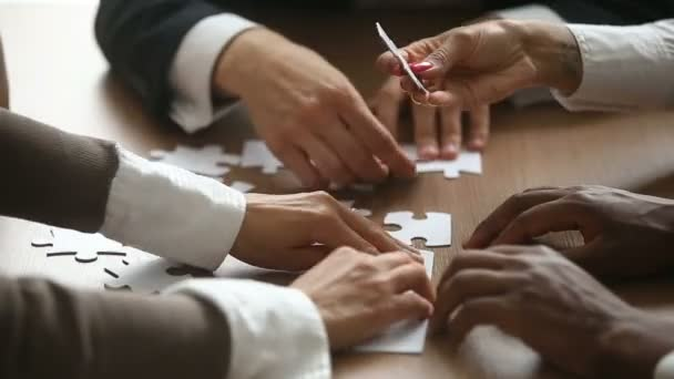 Business people trying to connect jigsaw puzzle, teamwork support concept