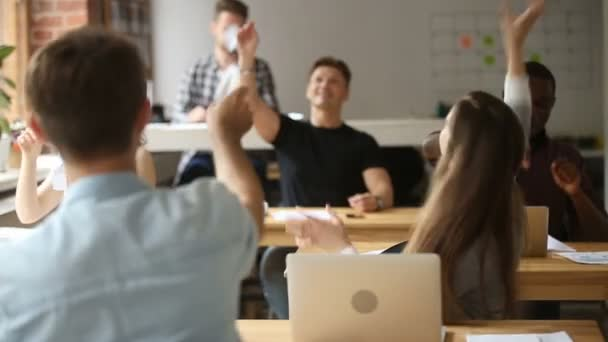 Happy multi-ethnic business team launching paper planes in coworking space
