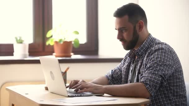Happy man excited about win online looking at pc screen