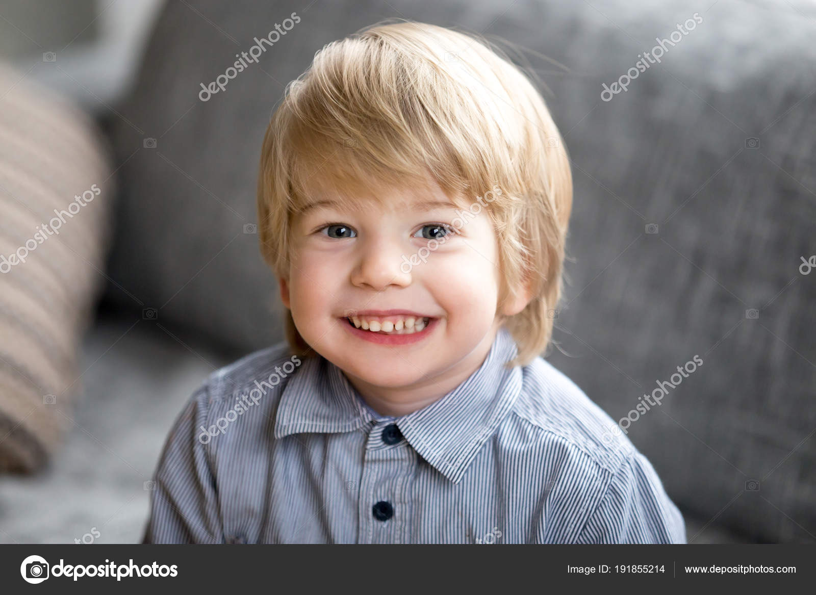 Headshot Portrait Of Cute Smiling Kid Boy Looking At Camera Stock