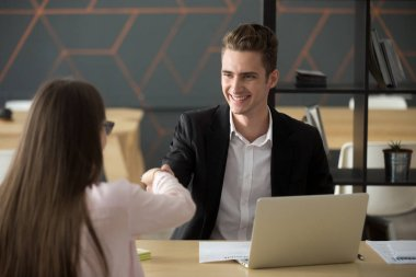Smiling hr employer handshaking successful job applicant hiring