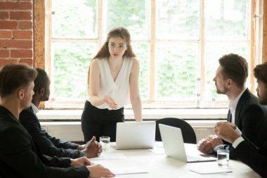 Female business woman coaching male subordinates