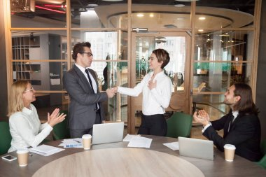 Boss promoting or introducing pleased businesswoman showing resp