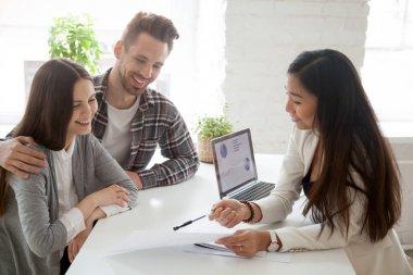 Asian realtor, insurance broker or financial advisor consulting