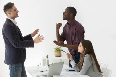 Diverse african and caucasian colleagues having dispute at group