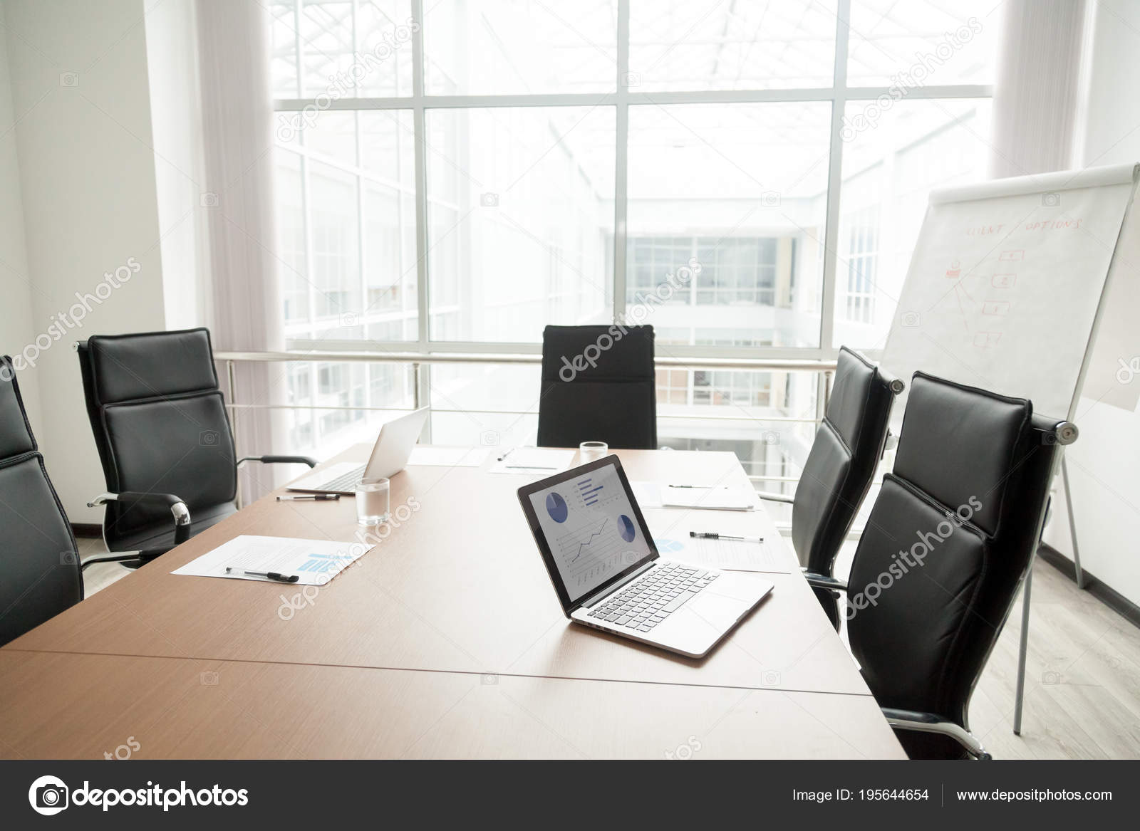 Modern office boardroom interior with conference table and big w 40