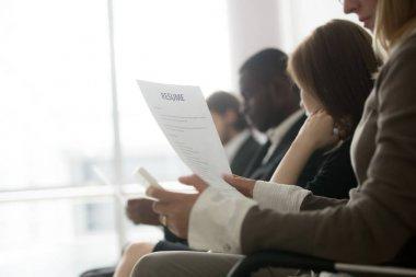 Multiracial business people waiting in queue preparing for job i