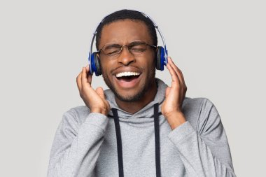 Head shot excited African American man listening to music