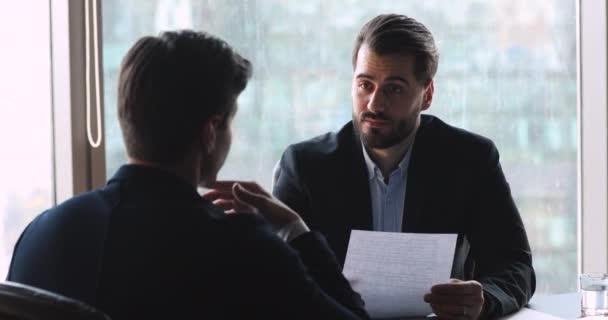 Businessman make agreement handshake business partner at meeting